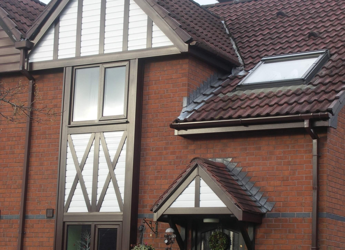 Rosewood roofline white cladding